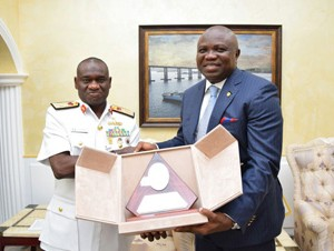 Lagos State Governor, Mr. Akinwunmi Ambode (right) receiving a plaque from the Chief of Naval Staff, Rear Admiral Usman Jibrin (left) during his visit to the Chief of Naval Staff at the Defence Headquarters, Abuja on Monday, June 29, 2015.