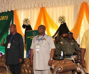 L-R Anambra state Governor, Willie Obiano,  IGP Solomon Arase, Abia state Governor Dr. Okezie Ikpeazu, and Gov. Ifeanyi Ugwuenyi of Enugu state observing the national anthem during the 2015 South East/ Delta States Security Conference at Awka,  Anambra state.   Photo: Ibeabuchi Abarikwu
