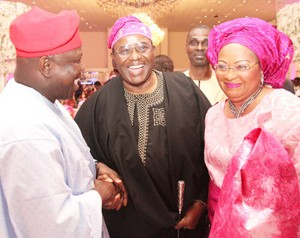 Lagos State Governor, Mr. Akinwunmi Ambode (left) with Chief Harry Akande (middle) and his wife, Tolulope during the wedding ceremony of Oyo State Governor Abiola Ajimobi's daughter in Ibadan at the weekend.