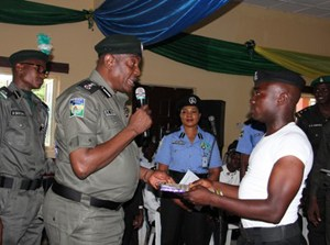 The IGP Issuing Certificate to Police Officers undergoing training at PMF Training Collage, Ila Oragun, Osun State