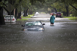 Clare Reigard of Georgetown, South Carolina, abandons her car after it stalled on Duke Street due to heavy rains in Georgetown, South Carolina October 4, 2015. Most major roads through the historical South Carolina city have closed due to flooding. Vast swaths of U.S. Southeast and mid-Atlantic states were grappling with heavy rains and flooding from a separate weather system which has already caused at least five deaths,