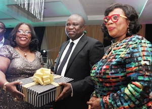 Lagos State Governor, Mr. Akinwunmi Ambode (middle), being presented a gift by the Chief Judge of Lagos State, Hon. Justice Olufunmilayo Atilade (left) during the 2015/2016 Legal Year Dinner, at the Law School, Victoria Island, Lagos, on Friday, October 2, 2015. With them is the Hon. Justice Opeyemi Olufunmilayo Oke (right).