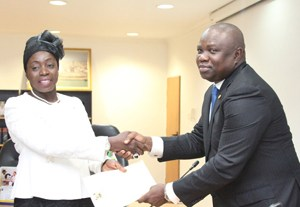 Lagos State Governor, Mr. Akinwunmi Ambode (right) congratulating Mrs. Lola Are-Adegbite after being sworn in as Tutor-General/Permanent Secretary for Education District IV, at the Lagos House, Ikeja, on Monday, October 05, 2015.