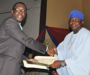 Lagos State Governor, Mr. Akinwunmi Ambode (right) congratulating Mr. Steve Ayorinde, after being sworn in as Commissioner for Information & Strategy, at the Adeyemi Bero Auditorium, the Secretariat, Alausa, Ikeja, on Monday, October19, 2015.