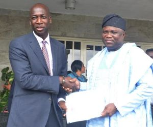 Lagos State Governor, Mr. Akinwunmi Ambode (right) being presented with a letter of Economic Partnership by the Managing Director, Unilever Group, Mr. Yaw Nsarkoh during a courtesy visit to the Governor by the Unilever Group, at the Lagos House, Ikeja, on Wednesday, September 30, 2015.