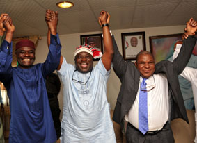 Abia state Governor, Dr. Okezie Ikpeazu (middle) flanked on the left by his deputy Rt. Hon. Ude Oko Chukwu and on the right by the State PDP Chairman Sen. Emma Nwaka celebrating with the governor after the tribunal affirmed his victory in Umuahia.