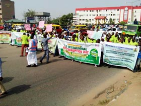Members of the Edo state civil society group led by Rev, David Ugolor, ED, ANEEJ in a procession to mark this year's Anti-Corruption Day in Benin, the Edo State capital, Wednesday