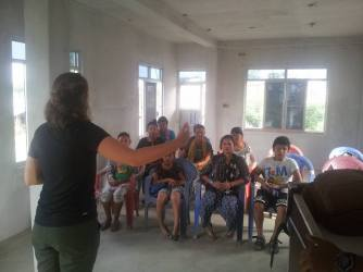 Sam Matras teaches introduction phrases during the first community English class. Less than 10 people came to the first community English class. Now, over 30 people consistently attend.