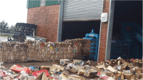 Bales of compacted cardboard produced by the waste pickers at the MRF. Photo: groundWork