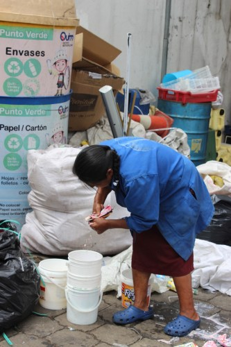 Woman Waste Picker sorting materials in an association in Quito