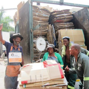 Afrika Ntuli (far left) and Maria Vilakazi (centre) celebrating Global Recyclers' Day on 1 March (2014) with their contribution of 1.5 tonnes of recyclables which amounts to saving 25 trees – with staff from a local recycling company. Photo: Tasmi Quazi.