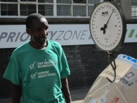 Afrika after weighing and selling 1 tonne of cardboard recyclables (March 2012) seen wearing the Global Alliance of Waste pickers t-shirt which highlights the devastating socio-economic impact that waste incinerators would have on the livelihoods of informal recyclers. Photo: Dennis-Lee Stols.