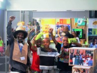 Afrika with visitors to the AeT Projects stall at the 2013 Sustainable Living Exhibition with his signature fist pump honouring informal workers' contributions everywhere. Photo: Tasmi Quazi.