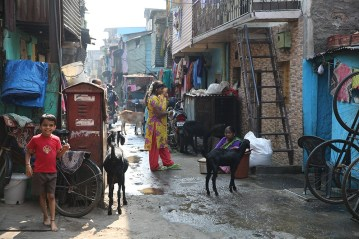 People walking in the alleys of the slum.
