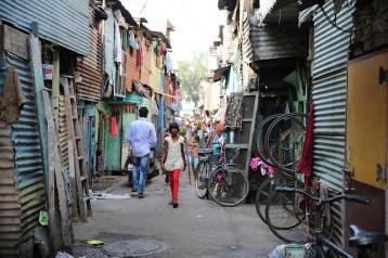 A girl walks through the narrow alleys of the slum.