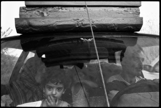 SOUTHERN LEBANON - August, 2006: A family flees southern Lebanon. A 48-hour cease fire of aerial bombardment by the Israeli military allowed some of the remaining residents to leave. Israel rejected the possibility of an immediate cease-fire in Lebanon as it poured soldiers and artillery shells across the border, vowing to press ahead with its ground war before diplomacy forces it to stop. (Photo by Farah Nosh)