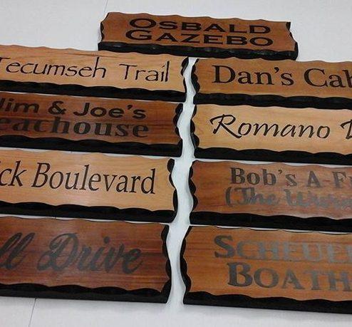 Wood signs, vinyl lettering