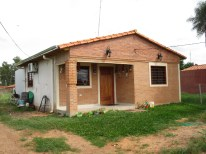 A completed Habitat house near one of the one's we were building.
