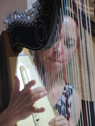 Genean trying her hand at harp playing