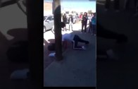 Girl plays dead in the middle of a fight