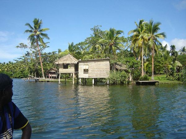 View of a typical house besides the water. Photo by Phenss.