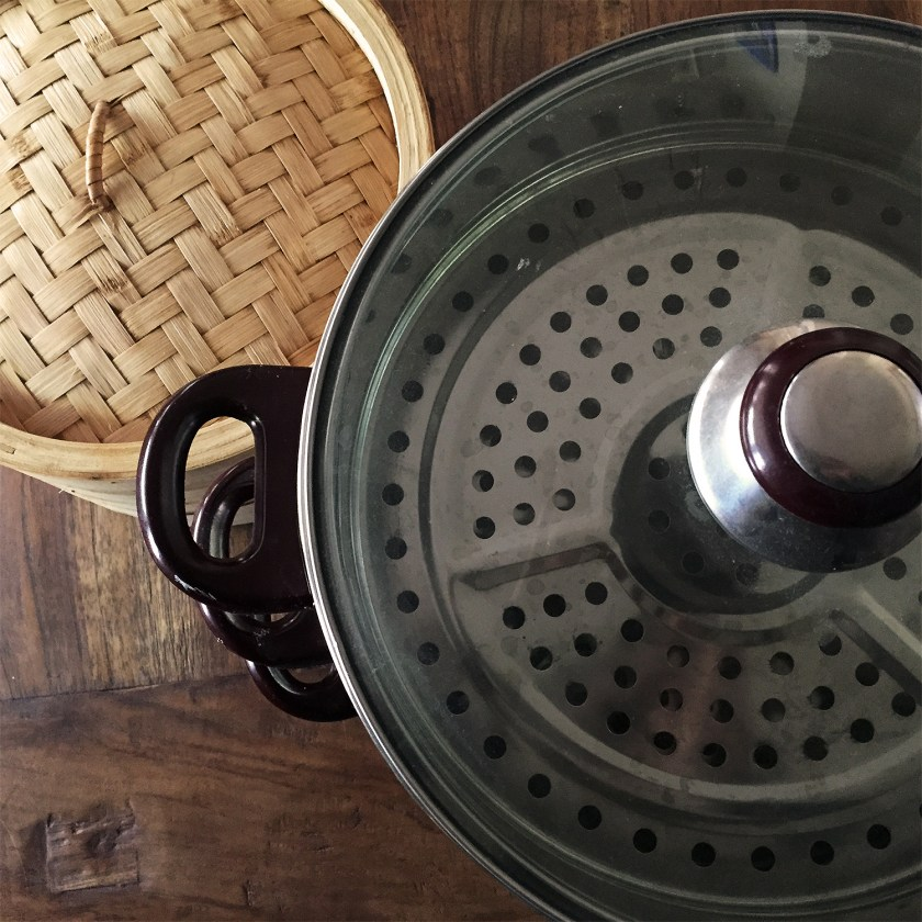 Steamer Baskets choices - bamboo or stainless steel. Bamboo imparts flavor, stainless does not.
