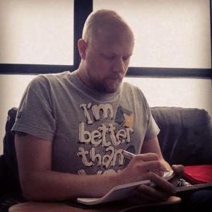 J.P. Kallio wears t-shirt