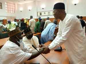 Senator Usman Jibrin Wowo, exchange pleasantries with Chairman of APC in the FCT, Alhaji Abdulmalik Usman, during the party's stakeholders meeting in Abuja on Wednesday