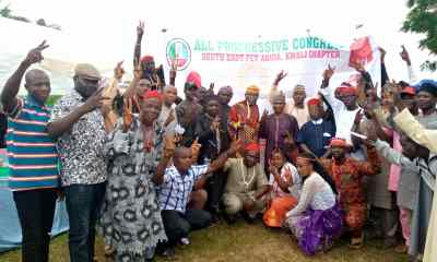 The Kwali chapter of the APC south east forum poses behind banner after endorsing chairman of Kwali Area Council for second term