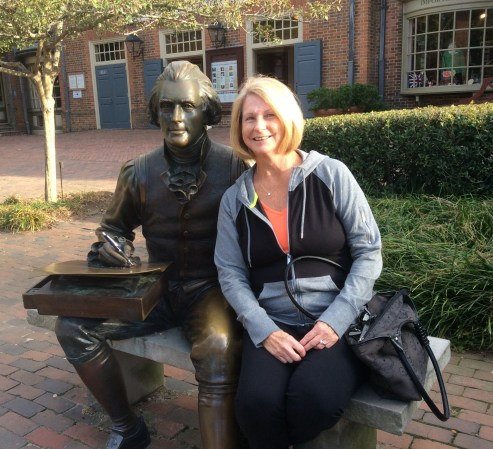 Member Barb G. lends Thomas Jefferson a pen in Colonial Williamsburg.