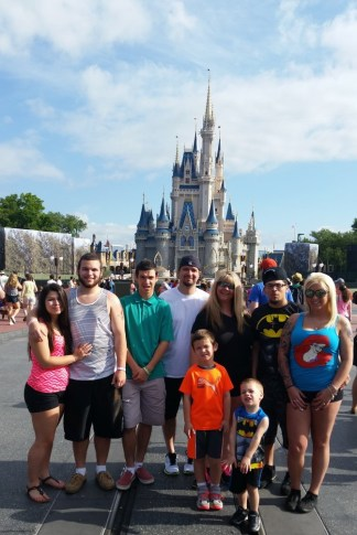 Member Ericka D. and her family enjoying their time in front of Magic Kingdom.