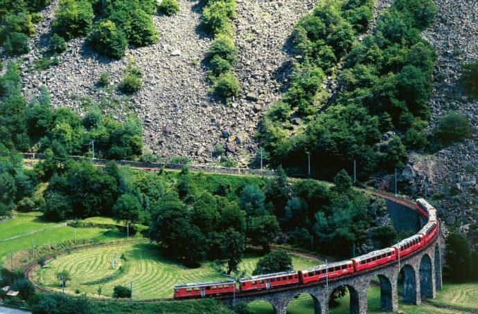 The Bernina Express negotiates the Brusio Circular Viaduct. Photo Credit: Hans-Rudolf Stoll/Flickr
