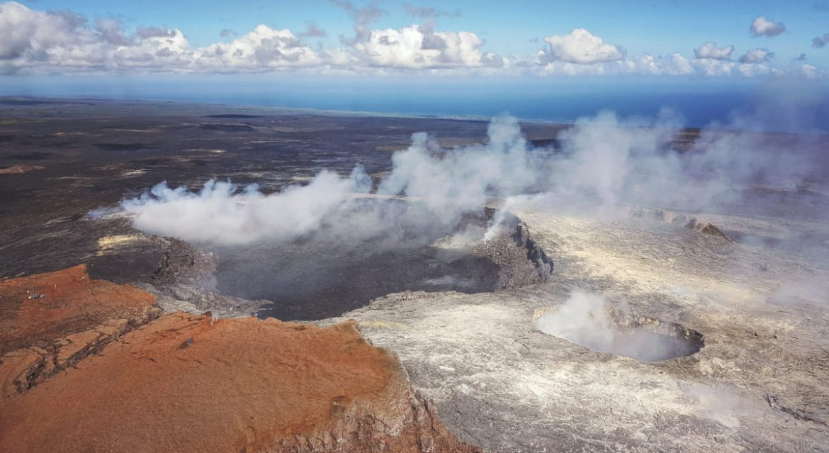 """Volcanoes National Park via helicopter provided a stunning overhead view of Kilauea Caldera and Halemaumau Crater."""