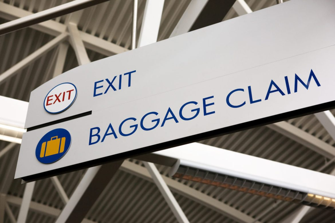Baggage claim and exit sign in an airport