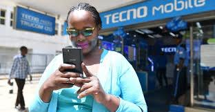 A black woman using Tecno phone