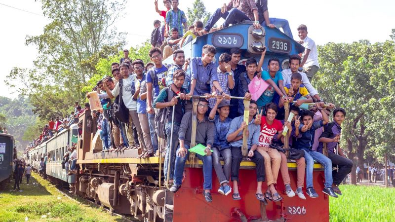 This shuttle train to Chittagong University has no place to sit, even on the roof. So the engine has been occupied. Image by Mainul Islam Shimul via Bangladesh Railway Fan Group. Used with permission.