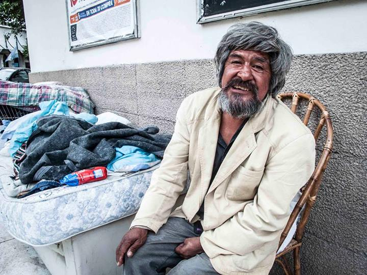"""He lives on the street with a friend. They have 2 mattresses, a couch and 3 chairs (one for guests). He invited me to sit down besides him, after some minutes chatting."" Photo by, Shared on Facebook and used with permission."