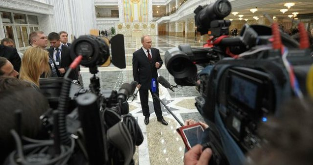 Vladimir Putin speaks to the press at a conference in Minsk, April 29, 2014, Kremlin photo service, public domain.