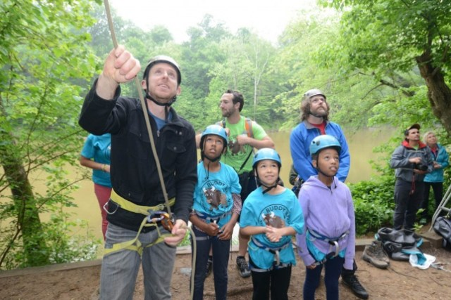 Rock climber Tommy Caldwell and rising fourth-grade students watching a climb in the Carderock section of C&O Canal National Historical Park_0