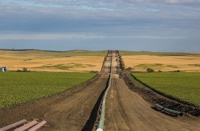 A pipeline installation between farms, as seen from 50th Avenue in New Salem, North Dakota. A key part to Trump's infrastructure plan is more support for fossil fuel development