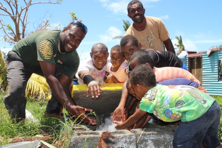 Children and villagers of Malake Island off Rakiraki at their water flush-out point.