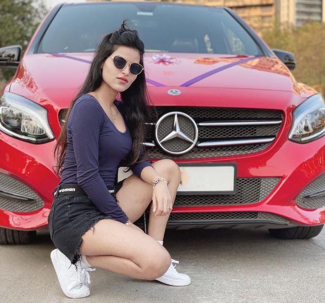 Unika Ray with BMW Car