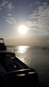Early morning sun leaving Caye Culker Belize on a water taxi