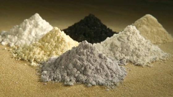 Rare-earth oxides (clockwise from top center) praseodymium, cerium, lanthanum, neodymium, samarium, and gadolinium. (Image Credit: U.S. Department of Agriculture/Peggy Greb)