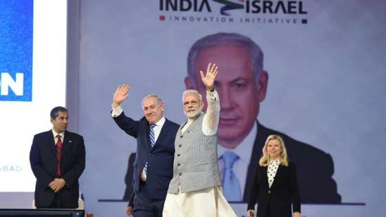 Israeli Prime Minister Benjamin Netanyahu and Indian Prime Minister Narendra Modi greet the audience at the dedication of an entrepreneurship center in Ahmedabad, India on January 17, 2018. (Image Credit: Prime Minister of India Office)