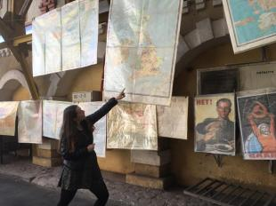 Admiring maps and Soviet posters