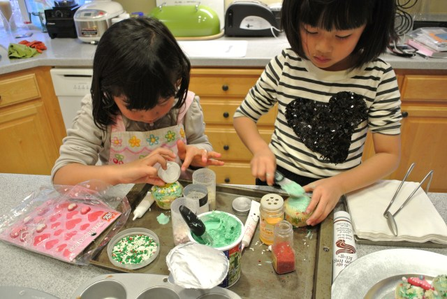 The two little elves working hard on their homemade cupcakes