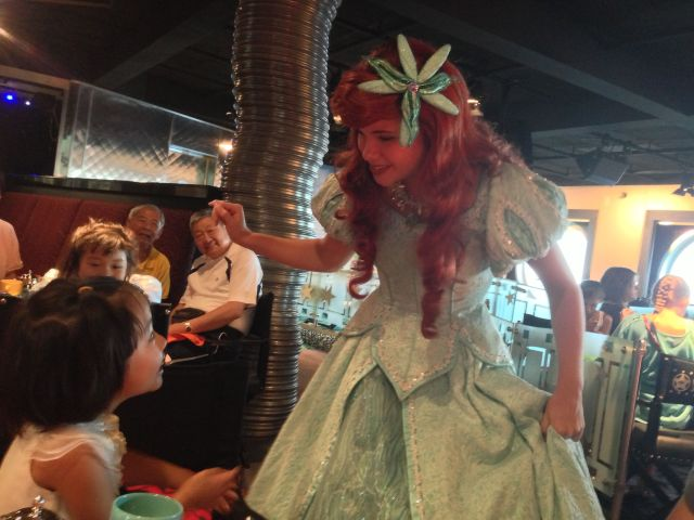 Ariel coming by our table to chat with the girls