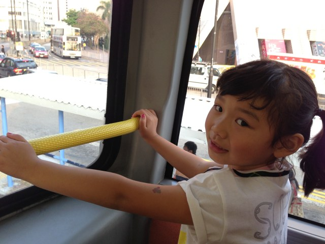 Her favorite seat on the double decker buses