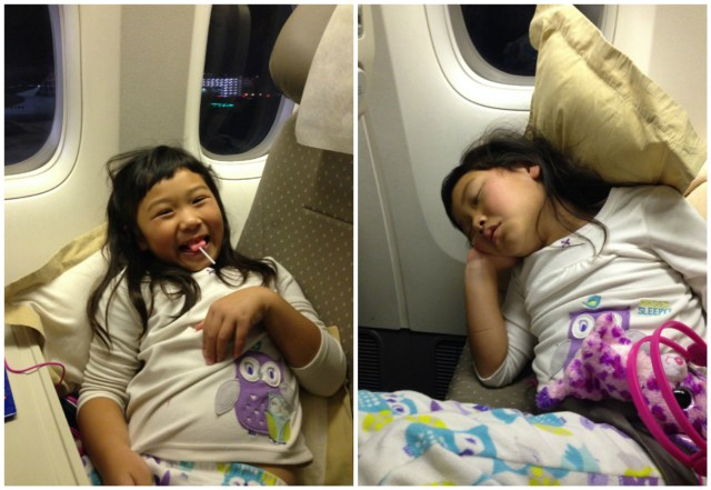 Over a dozen international flights in her life, she's got her system down! Lollipops help with the pressure in her ears during take off and landing. :)